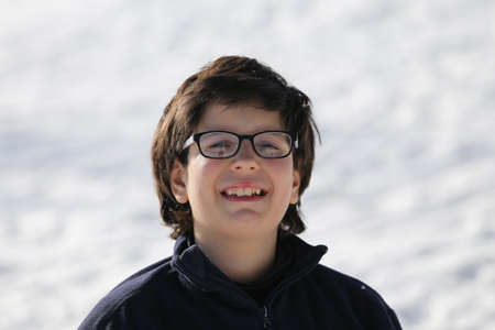myopic: Portrait of Italian boy with winter clothing in the mountains in winter