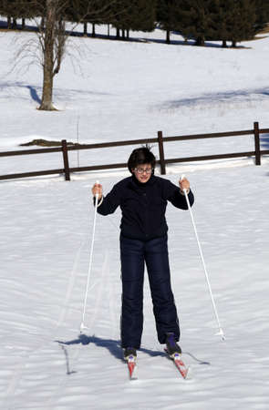 learns: young boy learns to ski cross-country in winter Stock Photo