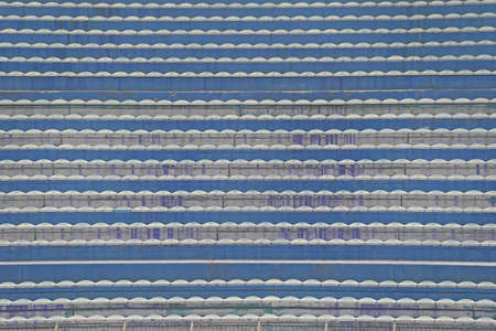 without: empty stands and the bleachers without people at football stadium