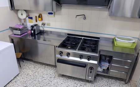 industrial kitchen: industrial kitchen with big steel stove to cook lunches to many people