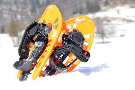 snowshoes: orange snowshoes in mountains in winter