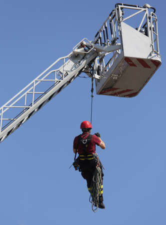 rappel: firefighter climbing during the practical exercise in fire station Stock Photo