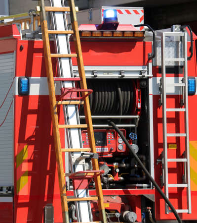 fire engine: wooden ladder in the red fire engine