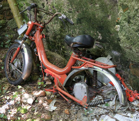 old moped inoperative abandoned in an old farmhouse