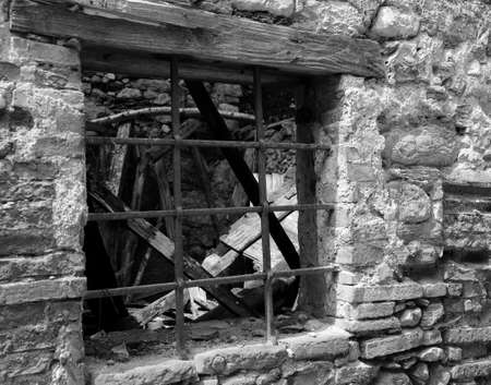 old window gratings of the old house destroyed by the earthquake