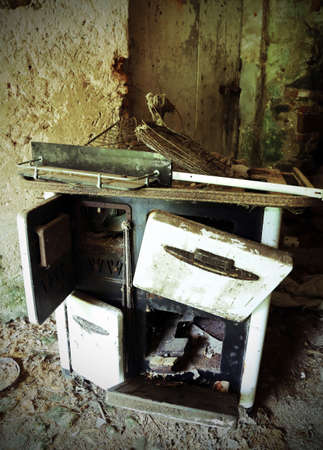 woodburning: Rusty wood stove of old kitchen in an old abandoned house