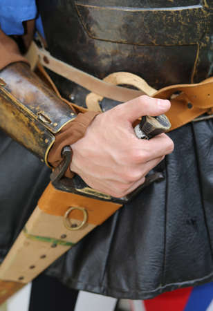 historian: medieval soldier his hand on the knife during a combat reenactment of the middle ages Stock Photo