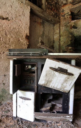 woodburning: ancient wood-burning stove of old kitchen in an old abandoned house