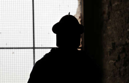 a watchman: shadow of soldier with medieval helmet on the ancient castle Stock Photo