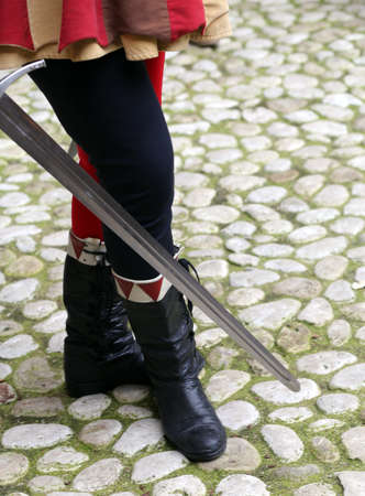 historian: medieval soldier with his hand on the sword Stock Photo