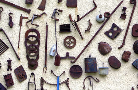 long  ago: many ancient farming tools hanging  of the rural House
