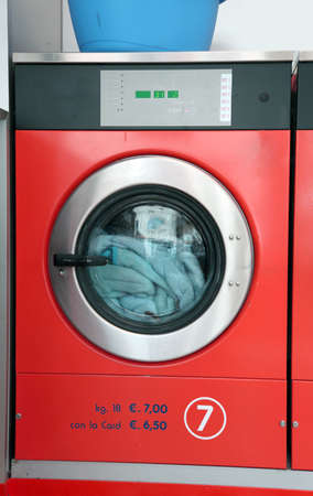 launderette: large industrial washing machine launderette with coin operation Stock Photo