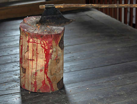flogging: ancient medieval axe of the executioner over the wooden log