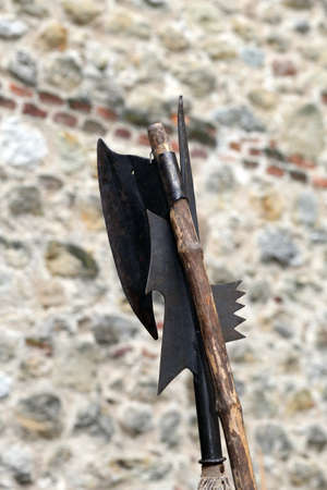 halberd: ancient axe and medieval halberd during combat in the Castle