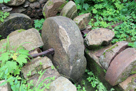 water mill: ancient stone wheel of abandoned water mill to grind flour in old farm