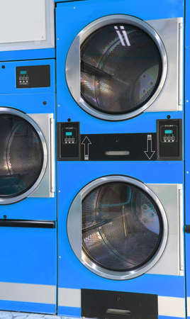 laundromat: blue automatic dryers coin operated in the laundromat