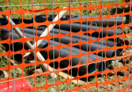 pipework: Road yard with conduits and the orange mesh of the site protection
