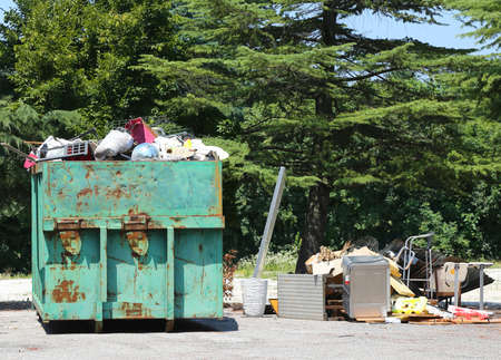 removals: containers full of garbage and waste after the eviction of the industrial building