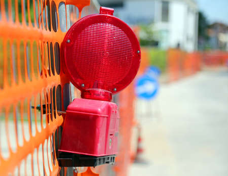 fiber optic lamp: Road yard with red signal lamp on road excavation