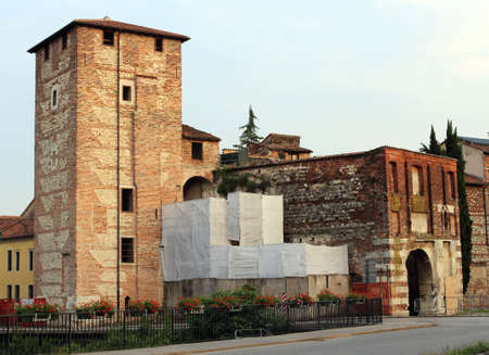 historian: ancient door and walls of the medieval town of Vicenza in Italy Stock Photo