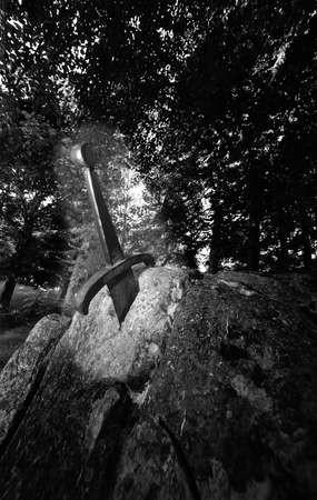 arthur: excalibur the famous sword in the stone of king Arthur in the forest