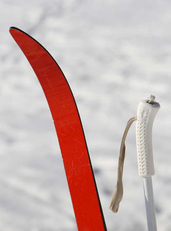 cross country: red cross country skiing in the mountains with snow