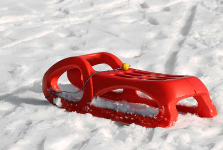 reb: reb sled for playing in the snow in mountains in winter