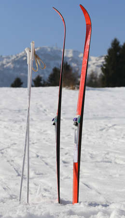 cross country: red cross country skiing in the mountains