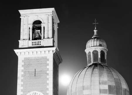bell tower: famous cathedral at night with bell tower in european city