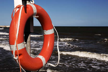castaway: Orange jackets with rope to rescue swimmers in the sea in summer