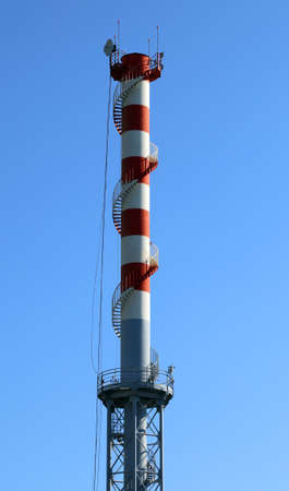 highest red and white smokestack with  the antennas for the transmission of signals