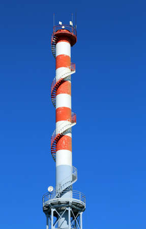 smokestack: highest red and white smokestack with  the antennas for the transmission of signals