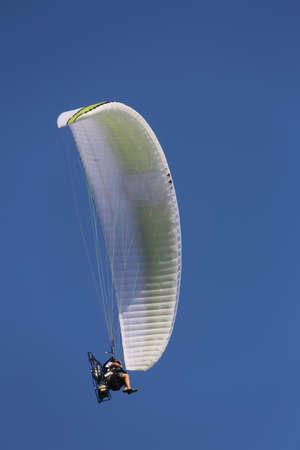 daredevil: Daredevil pilot with the motor glider flies fast Stock Photo