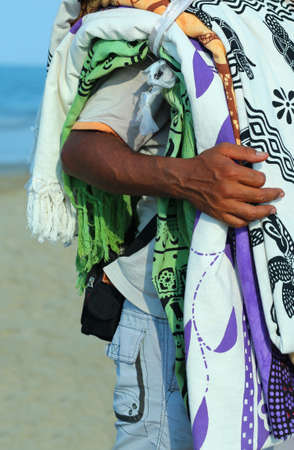 street vendor: street vendor of fabrics and Slipcovers on the beach in summer