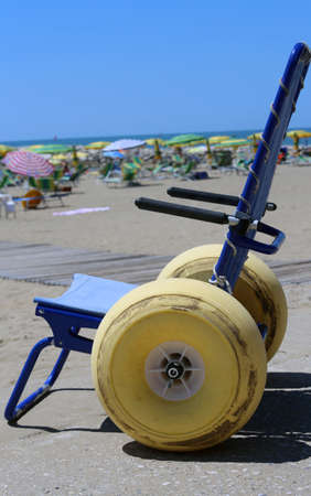 wheel chair: Special wheelchair with large floats wheels to go in the sea in summer
