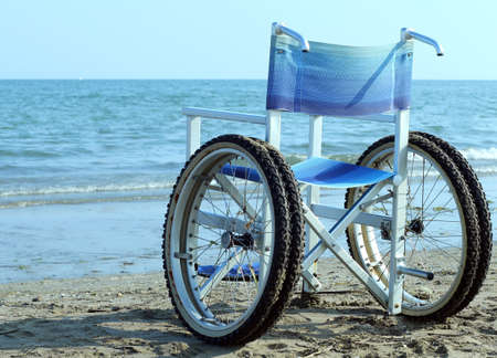 orthopaedic: Special wheelchair with wheels and tires to go into the water