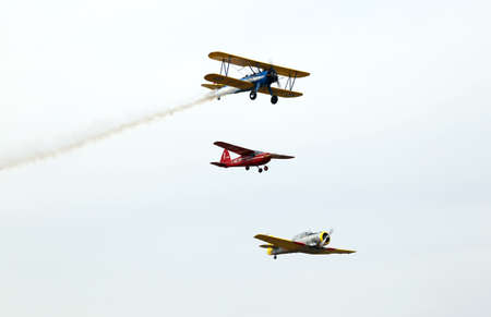aerobatics: Thiene, Vicenza - Italy. 26th July, 2015: important air show called FlighThiene in Thiene Airport near Vicenza City in Northen Italy with many historical and modern airplanes.Three aircraft aerobatics in the sky