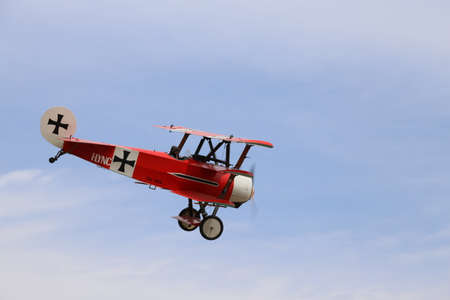 a war historian: Thiene, Vicenza - Italy. 26th July, 2015: important air show called FlighThiene in Thiene Airport near Vicenza City in Northen Italy with historical airplanes. Red Triplane Fokker DR-1