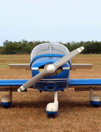 light aircraft: light aircraft at the airport with a big propeller ready for takeoff Stock Photo