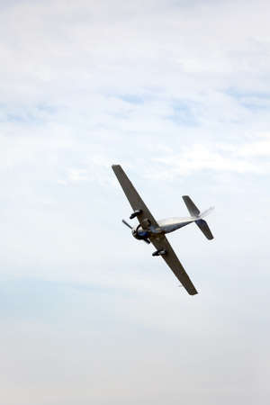historical events: great plane flies into the sky and makes daring stunts