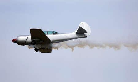 malfunction: historic warplane with dark smoke from the engine malfunction Stock Photo