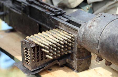 machine-gun: Army machine gun with ammunition during war exercises