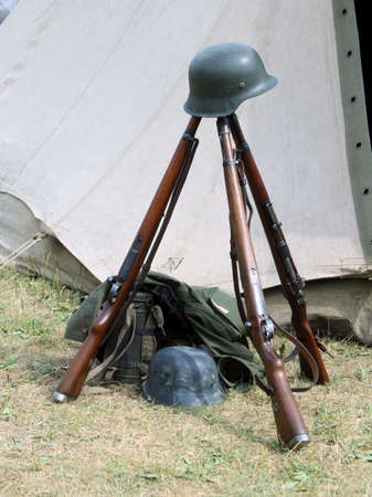 musket: old war rifles and helmets of dead soldier at war