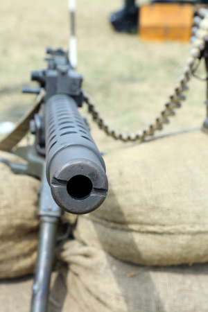 sandbag: cane of the machine gun in trenches with sand bags at war Stock Photo