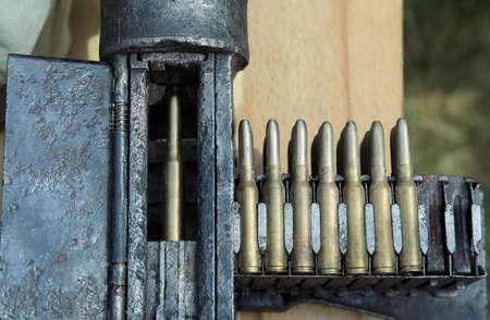 machine gun: Army machine gun with ammunition during war exercises
