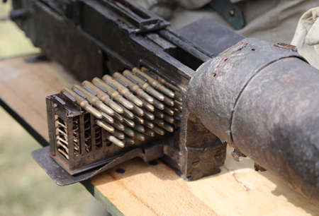 machinegun: charger with many bullets of a machine gun during a military war exercise