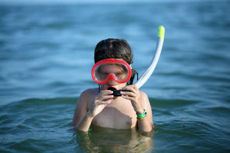 little girl swimsuit: little girl with the diving mask and snorkel at sea