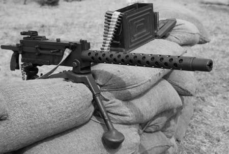 allies: historic machine gun with bullets over the sandbags used in trench warfare in World War II by the allies