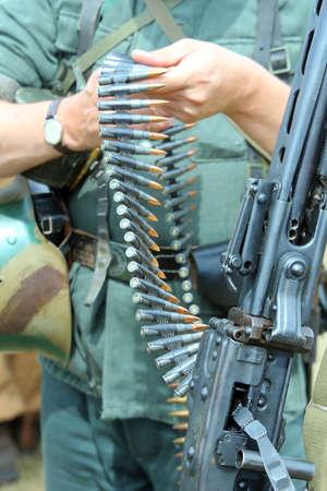 machine-gun: soldier with Army machine gun with ammunition during war exercises