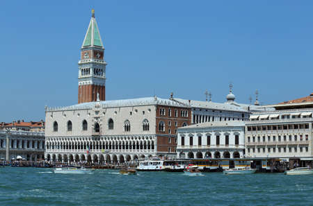 ve: Venice, VE - Italy. 14th July, 2015:  Doges Palace and the Bell Tower of St Mark and other palace with many boats and vaporetto ships on the adriatic sea